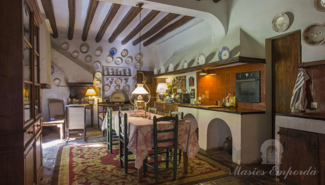 Kitchen of the main house with old bread oven with access to the porch and garden directly.