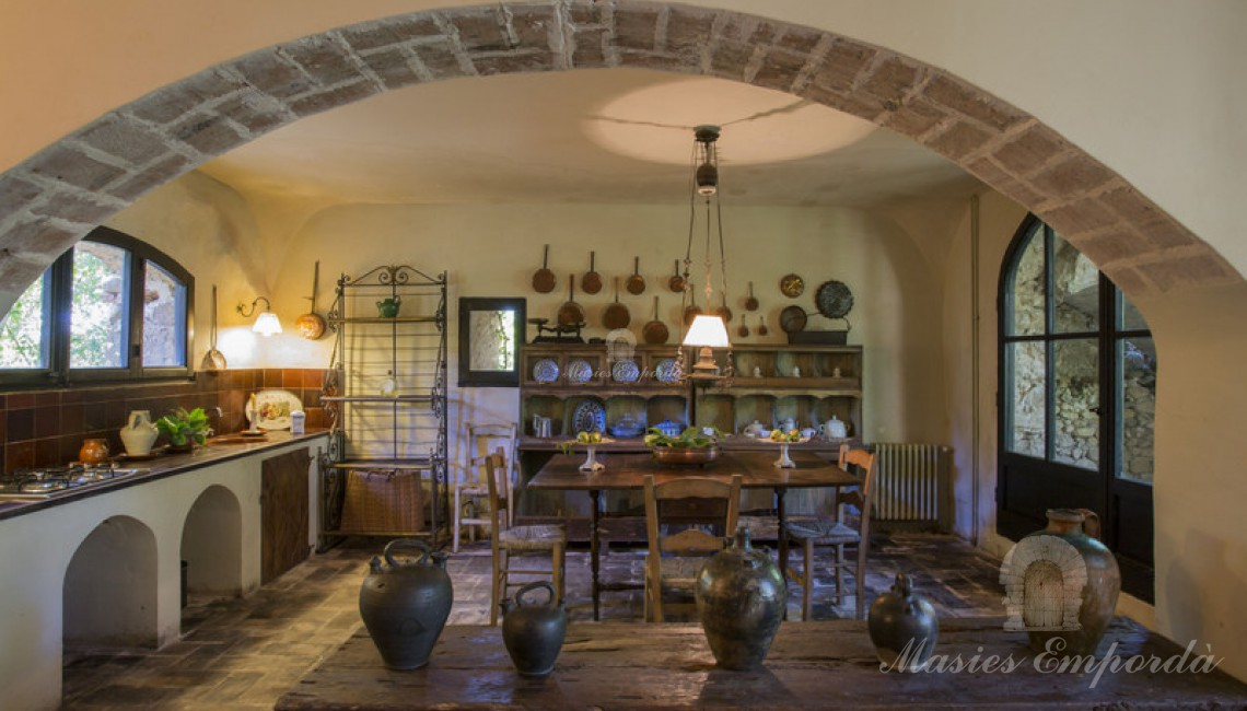 Detail of the kitchen dining room of the guest house of the property attached to the main farmhouse with loading stone arch of the second floor.