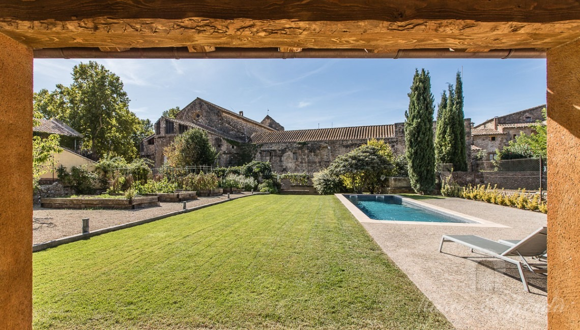 Views from the porch of the house the pool and the garden