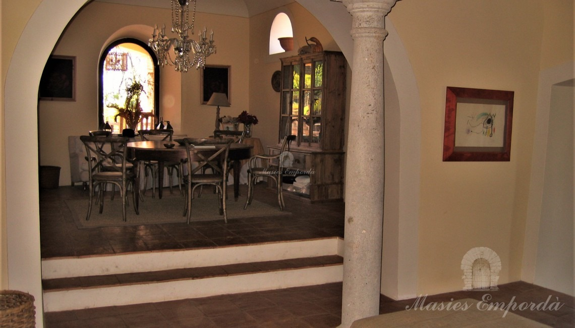 Entrance hall to the house and the daily dining room at the bottom of the image