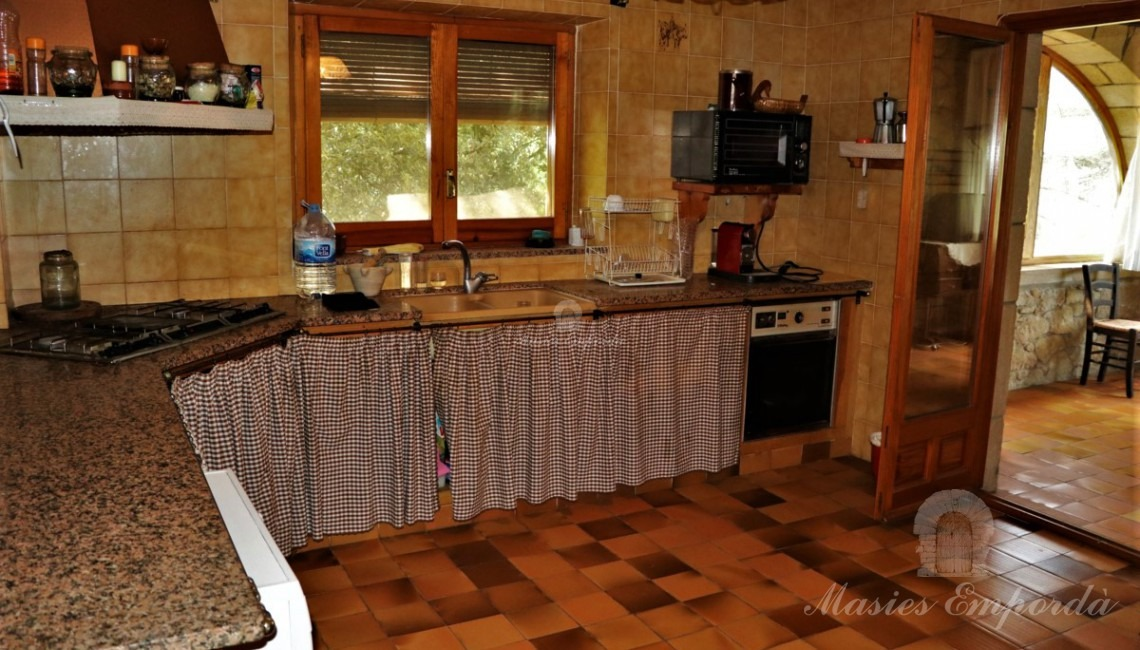 Kitchen next to the dining room