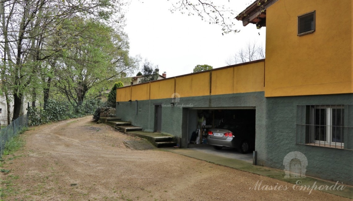 Views of the entrance to the garages and workshop.