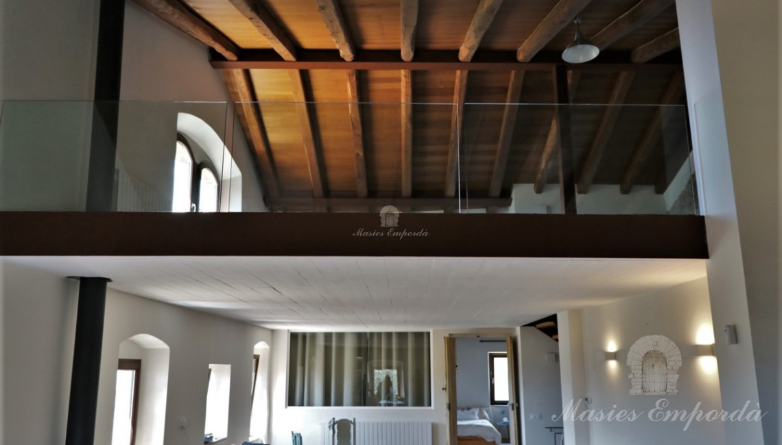 View of the living room and the attic from the dining room and kitchen