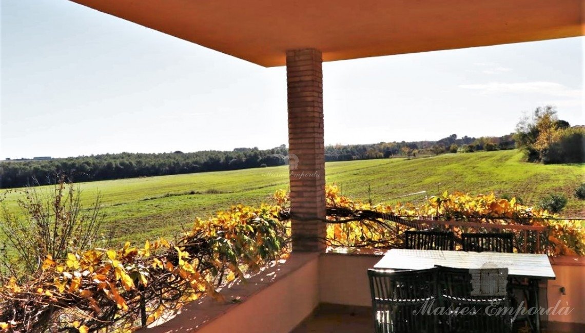 Terrace of one of the second-floor apartments with views of the fields