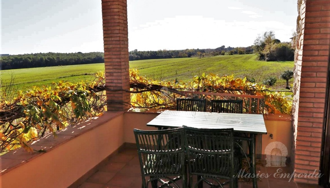 Terrace of the second floor apartment with views of the fields
