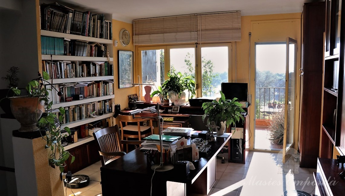 Office with exit to terrace overlooking the plot