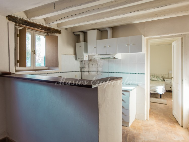 Kitchen and room