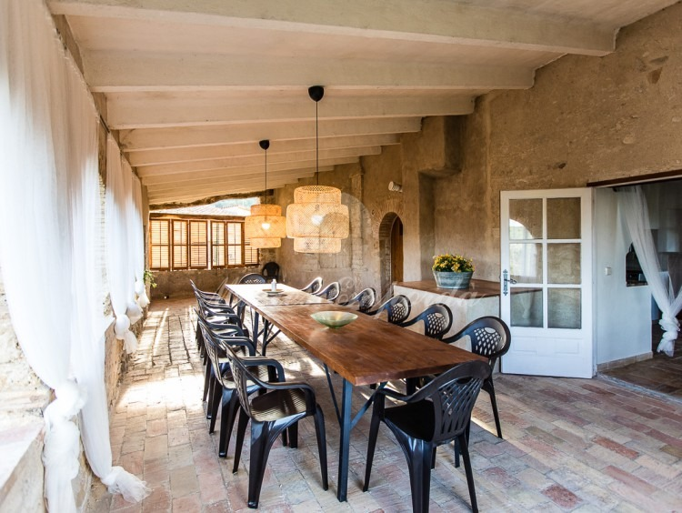 Terrace next to the kitchen with the summer dining room