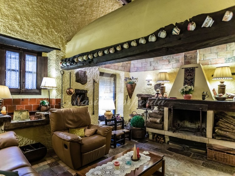 Views of the original kitchen of the farmhouse converted into a living room