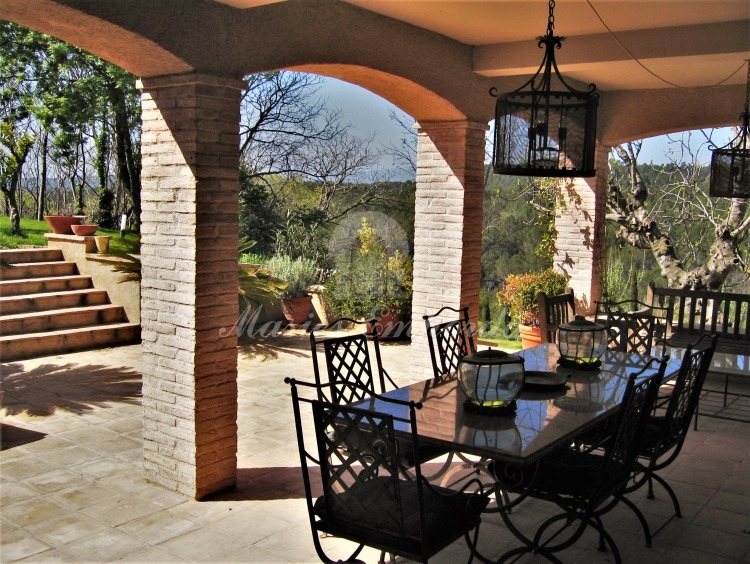 Porch with the summer dining room next to the kitchen