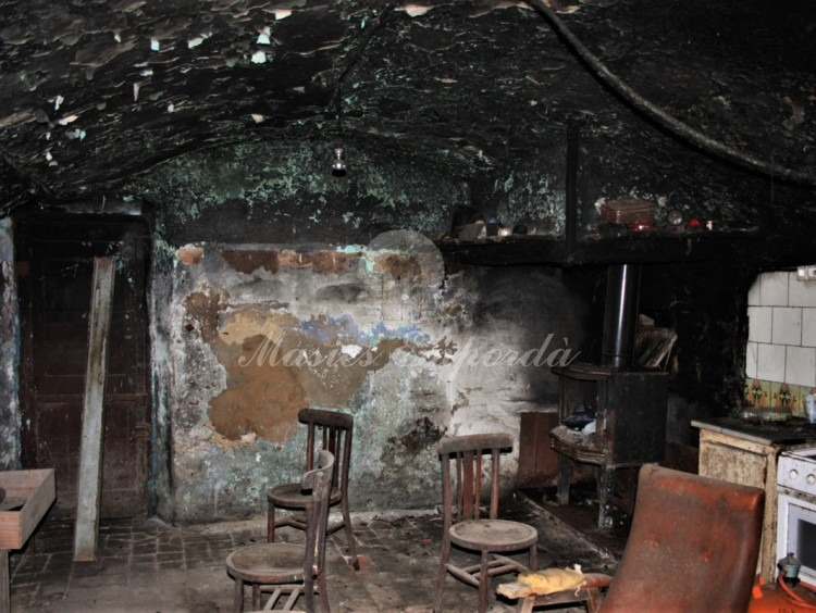 Detail of the soot on the walls and ceilings by the combustion of the fire in the kitchen