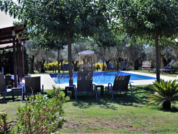 View of the garden and the pool area of the house
