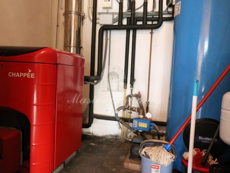 Boiler room and sanitary water storage tank on the ground floor.