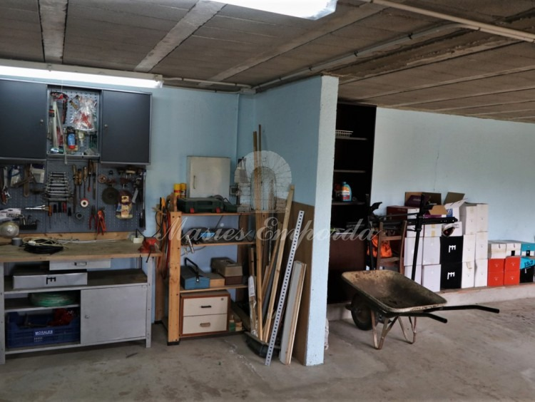 Interior view of part of the garage and workshop.