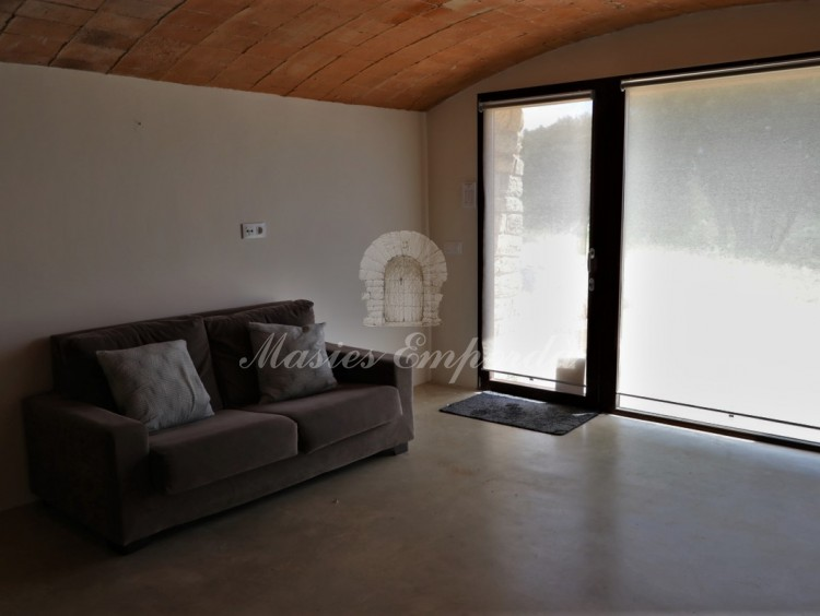 Lounge on the ground floor with access to the garden outside the farmhouse