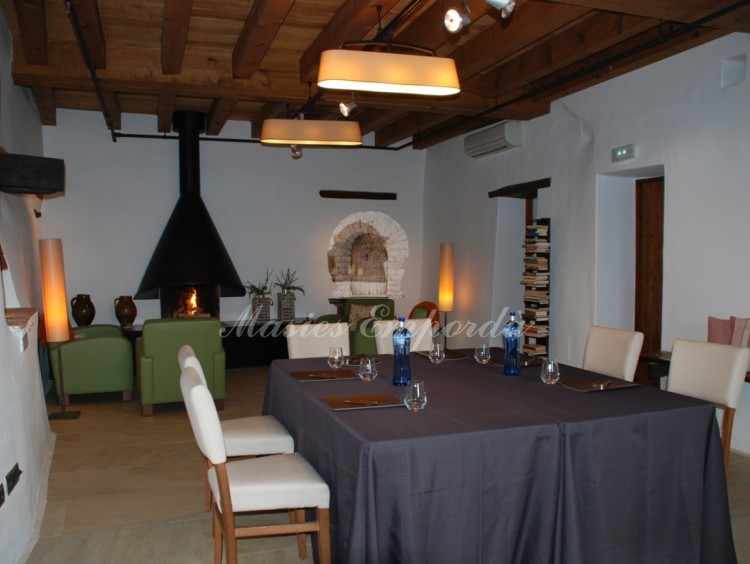 Dining room with fireplace in the part of the lounges and technical rooms